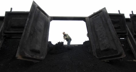 Image: A worker unloads coal