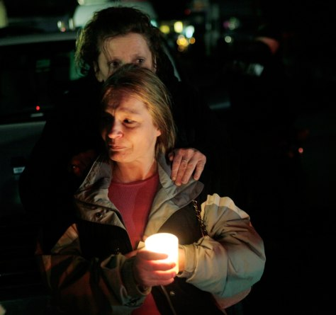 Image: Tammy Dettwiler comforts her sister Penny Flansburg