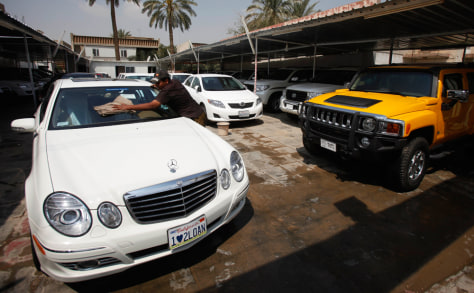 Image: An Iraqi car dealer is seen at his automobile lot in Baghdad.
