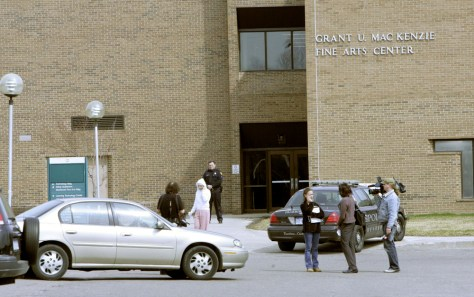 Image: Police officer stands outside the Grant MacKenzie Fine Arts Center