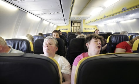 Image: Passengers sleep on a flight