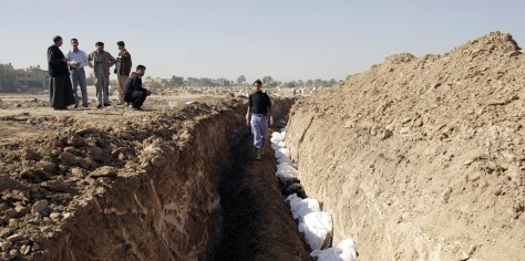 Image: Bodies in a mass grave in Baqouba, Iraq