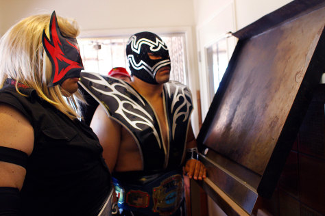 Image: Wrestlers Renegado and Mr. Tempest look at the griddle