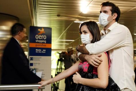 Image: A couple wearing masks