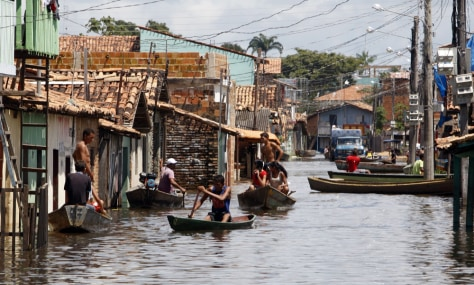 Image: Boats transport people along flooded streets in northern Brazil.