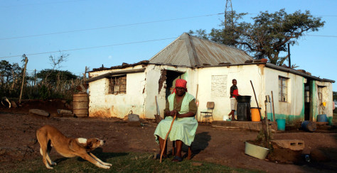 Image: Elizabeth Shange sits in yard of her homestead in KwaNxamalala, South Africa.