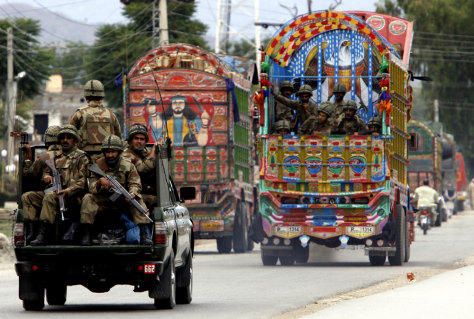 Image: Soldiers of the Pakistan army on their way to the troubled valley of Swat