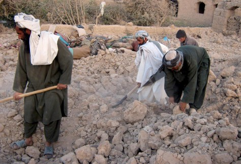 Image: Afghans search for their belongings amid rubble of their destroyed houses