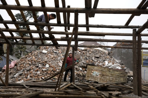 Image: Residents rebuild their homes months after an earthquake demolished a wide swathe of Luoshui, near Chengdu, southwestern China's Sichuan province
