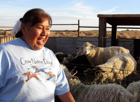 Image: Delores Claw with her sheep in Arizona