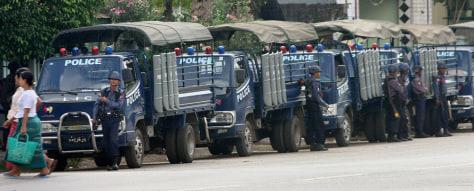 Image: Police trucks line a street in Myanmar's largest city Yangon