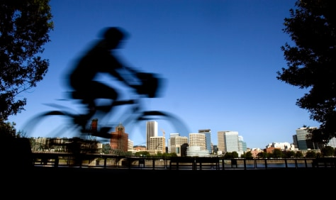 Image: Person rides a bike in Portland