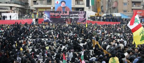 Image: Lebanese demonstrators listen to the speech of Hezbollah chief Hassan Nasrallah