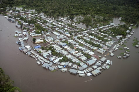 Image: An aerial view of the town of Anama, flooded by water from the Rio Negro