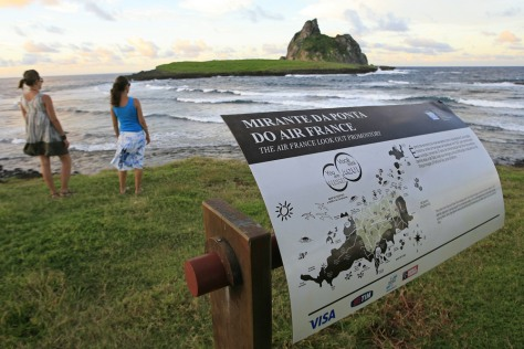 Image: Tourists walk at a lookout point near a former Air France communications base at Fernando de Noronha Island