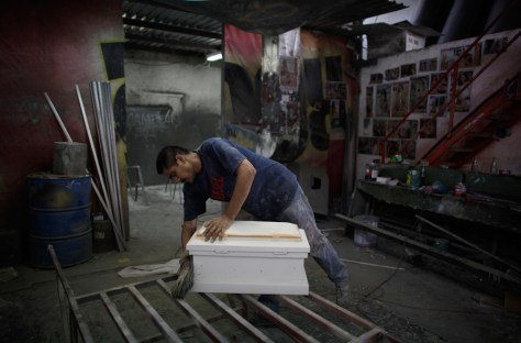 Image: Man works on a coffin