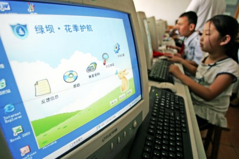 Image: Chinese students use computers installed with filtering software Green Dam-Youth Escort