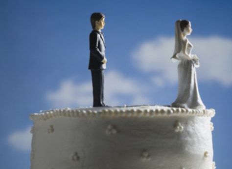 Image: Bride and groom wedding cake toppers