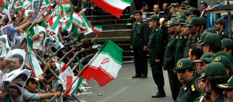 Image: Iranian Islamic Revolutionary Guards stand in front of tens of thousands