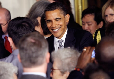 Image: Barack Obama greets guests