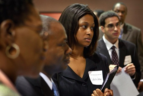 Image: Job seekers listen to a recruiter during a job fair held by the City Colleges of Chicago June 4, 2009 in Chicago.