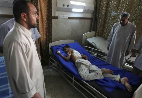 Image: Relatives visit an injured man
