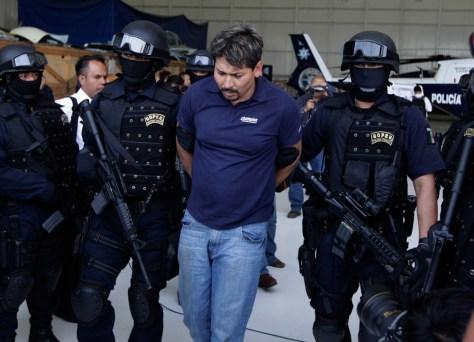 Image: Police escort Arnoldo Rueda
