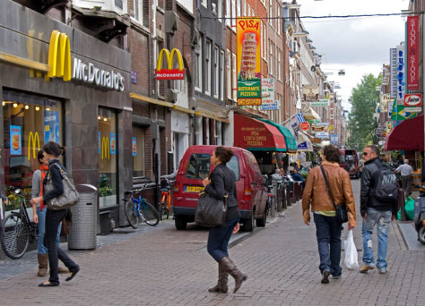 Image: Amsterdam street with a McDonald's and a pizza parlor
