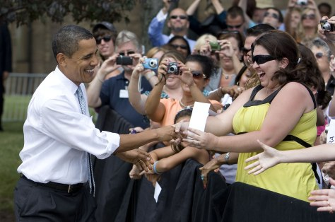 Image: Obama shakes hands before he speaks about education while visiting Macomb Community College in Michigan