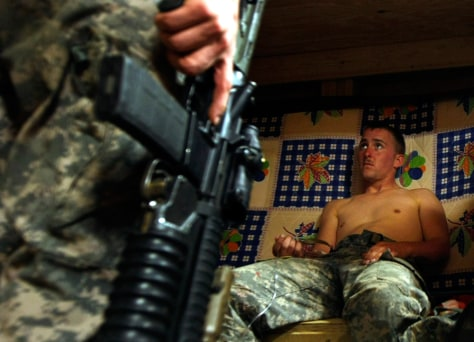 Image: U.S. soldier from Dagger Company, 2-12 IN, 4th Bgd rests after a foot patrol at Michigan Base in the Pesh Valley