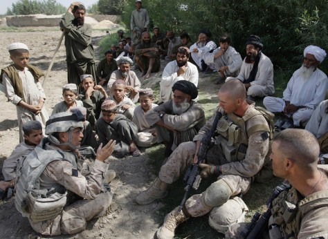 Image: Translator Josh Habib, bottom left, with Afghan villagers and Marines