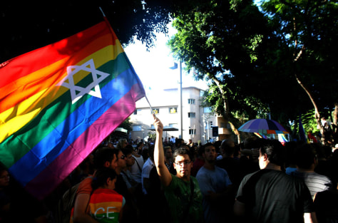 Image: Members of the gay community in Tel Aviv mourn deaths