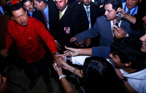 Image: Venezuelan President Hugo Chavez greets supporters