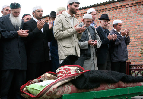 Image: People pray during Zarema Sadulayeva's funeral