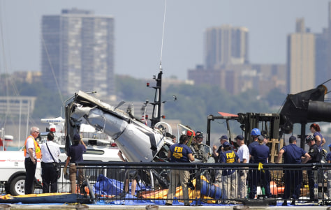 Image: Officials inspect wreckage
