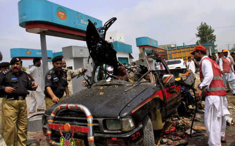 Image: Police examine a truck after a bomb blast in Pakistan