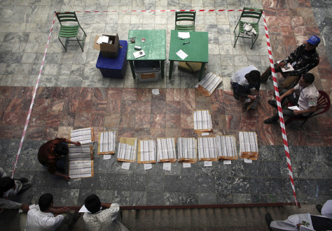 Image: Afghan election workers count ballots