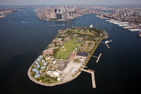 Image: Aerial photo shows Governors Island in New York harbor, with Manhattan in the background center.
