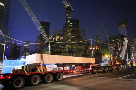 Image: A steel beam from the original World Trade Center is returned to the site