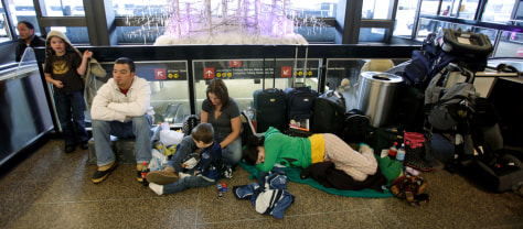 Image: Passengers sleep in airport