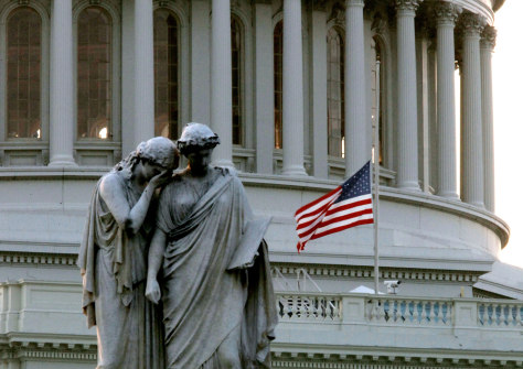 Image: Flags fly at half-staff in honor of Sen. Ted Kennedy at the Capitol building