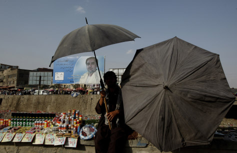 Image: A roadside vendor protects himself from the sun