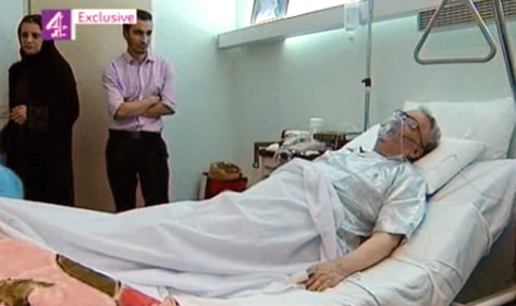 Image: Abdel Baset al-Megrahi in his hospital bed surrounded by family members
