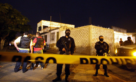 Image: Police guard the scene where 17 were killed in Mexico