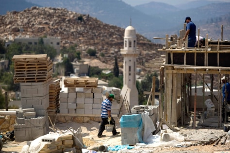Image: Construction workers at Jewish settlement in West Bank