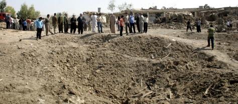 Image: Iraqis examine bomb crater