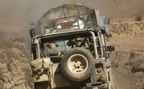 Image: German ISAF soldiers look out of their jeep during a patrol