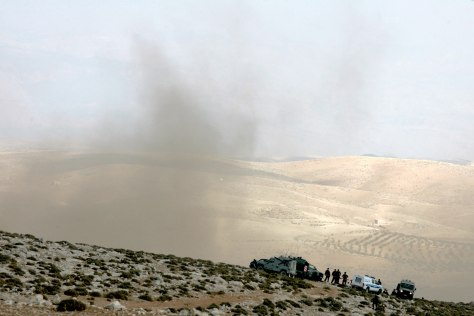 Image: Smoke billows from the crash site of an Israeli fighter jet