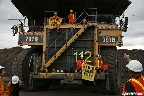 Image: Greenpeace activists take over mining truck