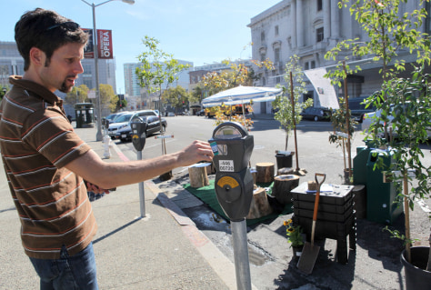 Image: Activists feed parking meter where park is set up